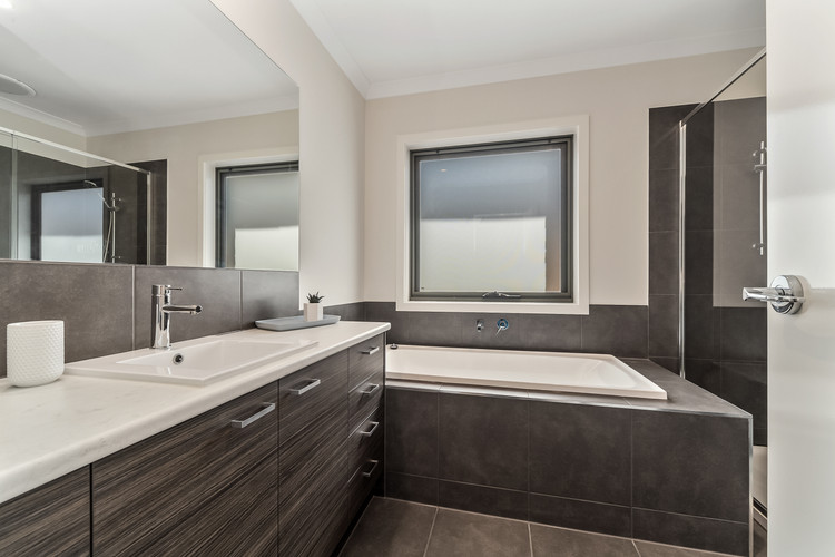 Central bathroom with full bath and shower, separate toilet