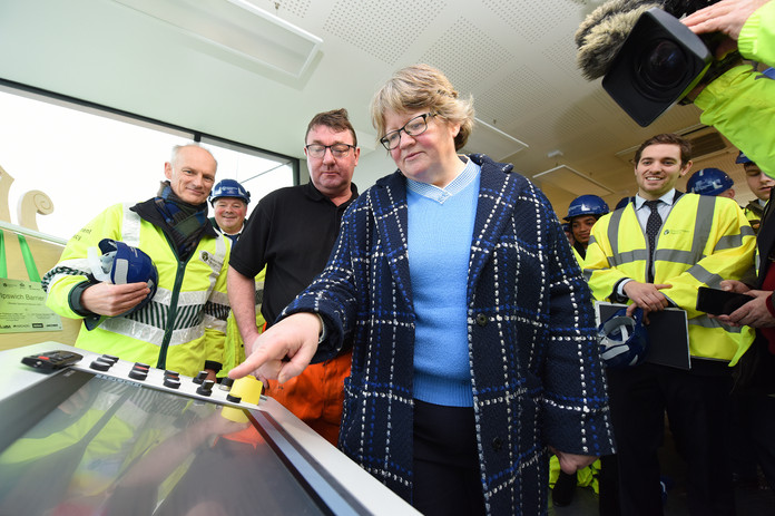 Therese Coffey, the Secretary of State for Work and Pensions, opening a new flood defence for the Environment Agency