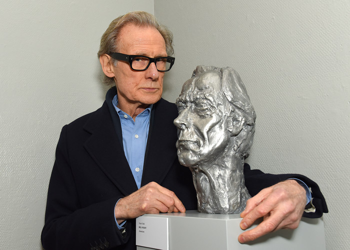 Bill Nighy with a sculpture of himself by Nicole Farhi