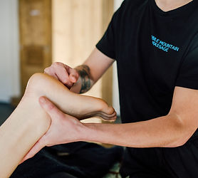 Therapist massaging a woman's foot with knuckles