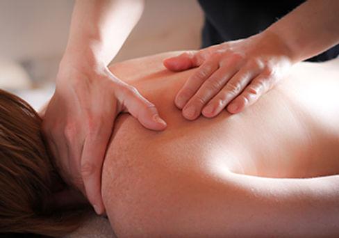 womans back with hands massaging he shoulder