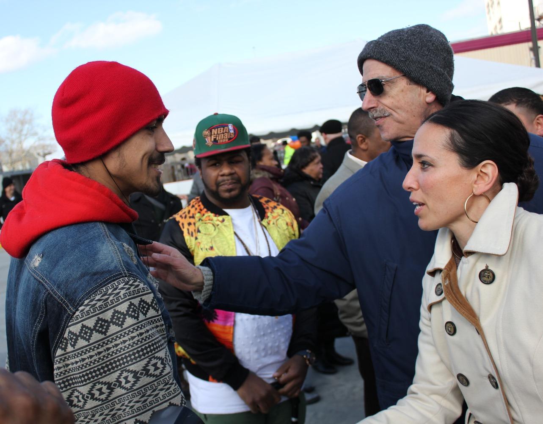 Sen. Chang-Díaz shakes hands at an event.