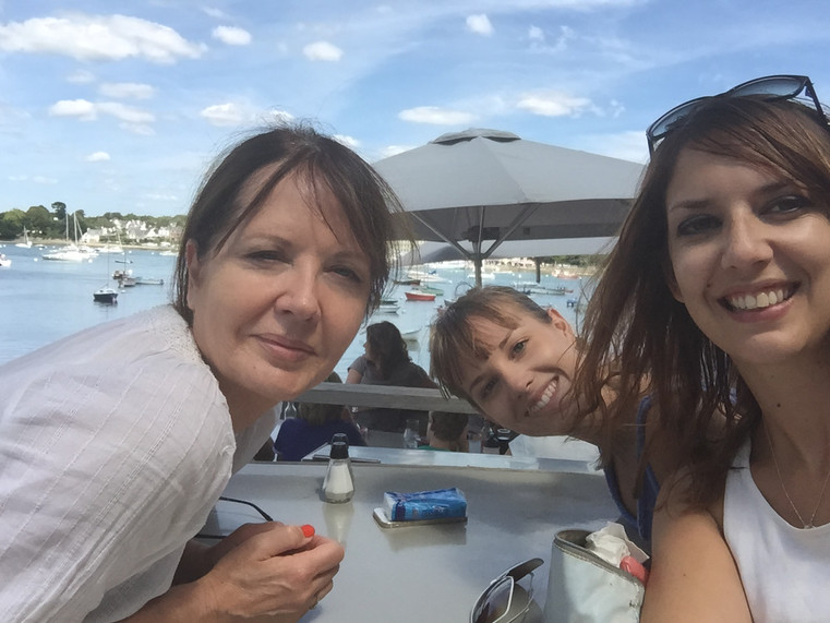 With my mom and sister eating crepes in Sainte Marine, Brittany. You must visit !