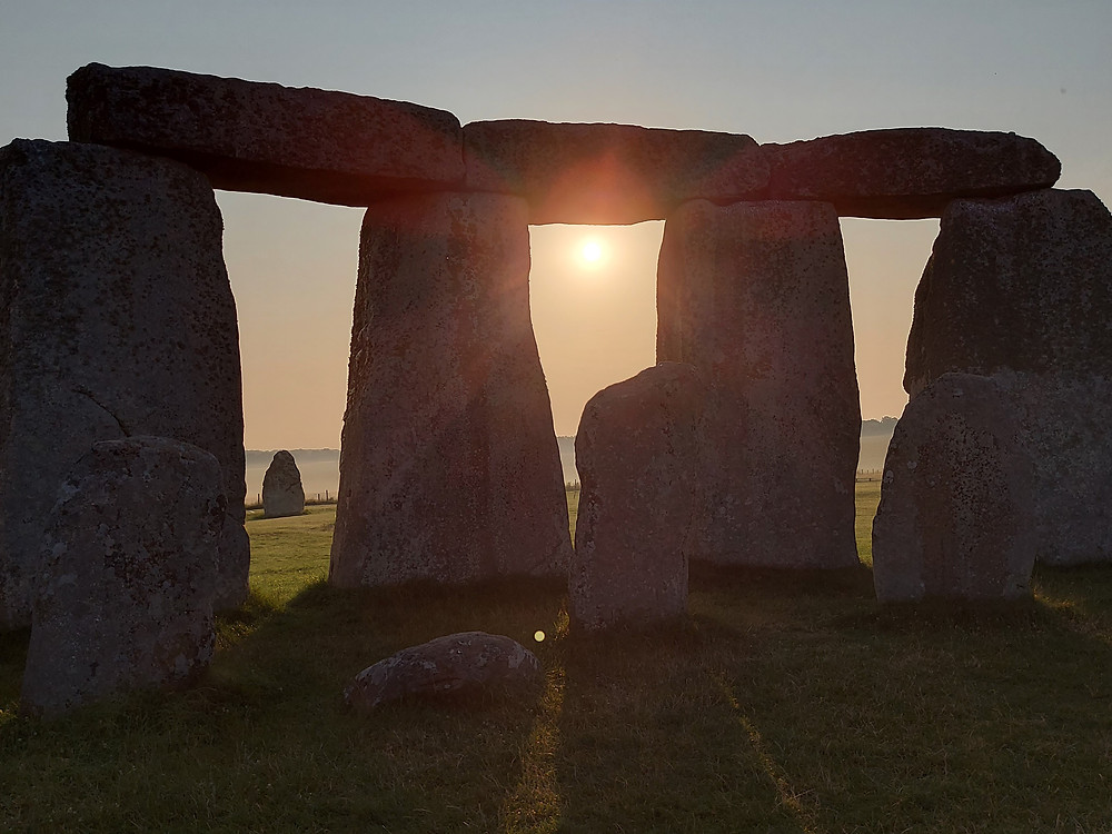The sun rises above Britain's most famous monument
