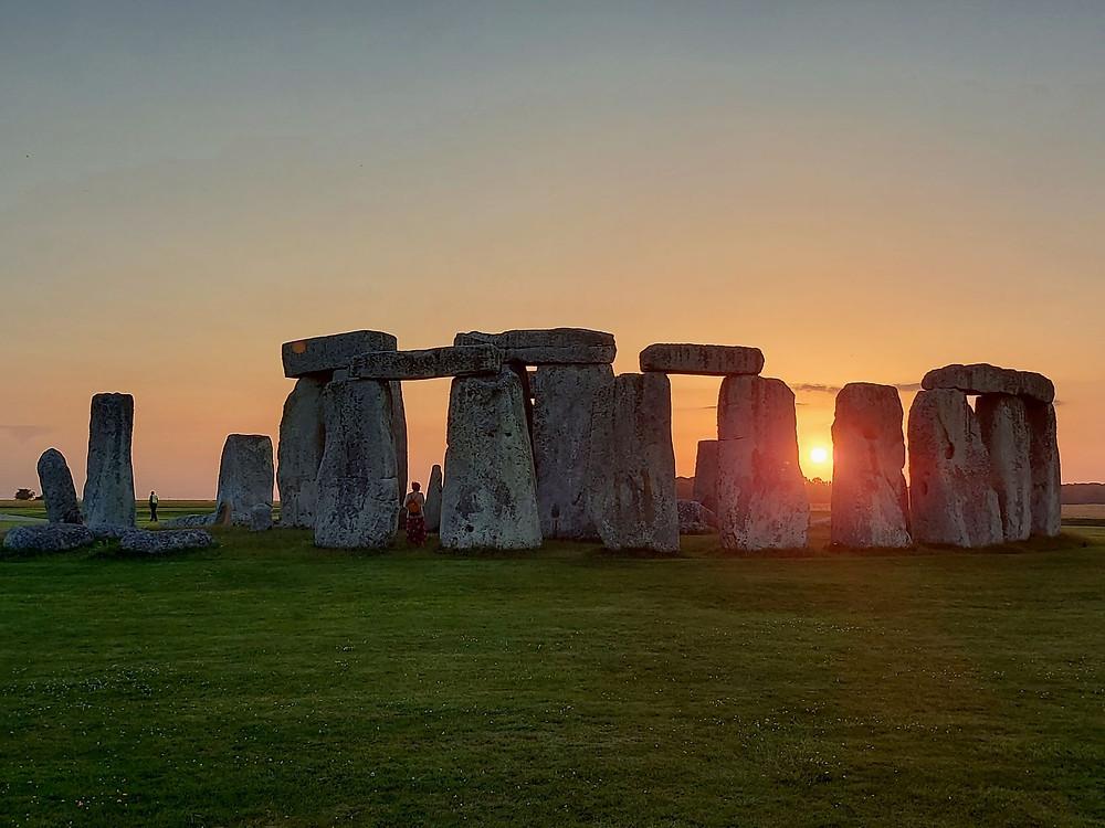 The sun setting behind Stonehenge