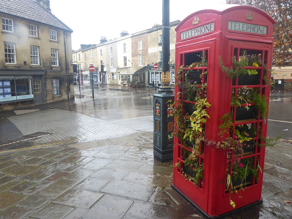 red telephone box on the streets of Bath