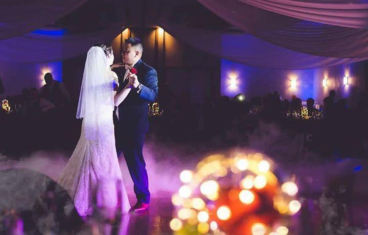 Katlin & Michael Zin celebrating their 1st dance on a cloud at a Disney inspired Kissimmee FL Wedding