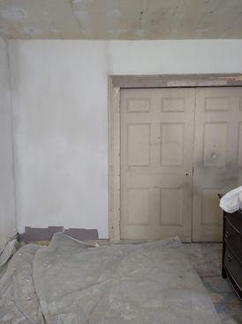 first floor plaster_pocket doors closed_