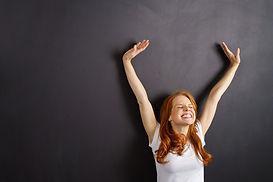 Happy_woman_stretching_767565826.jpg