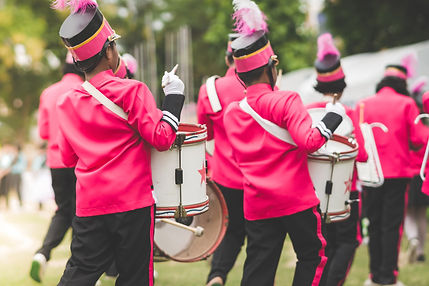 Marching band drummers perform in school