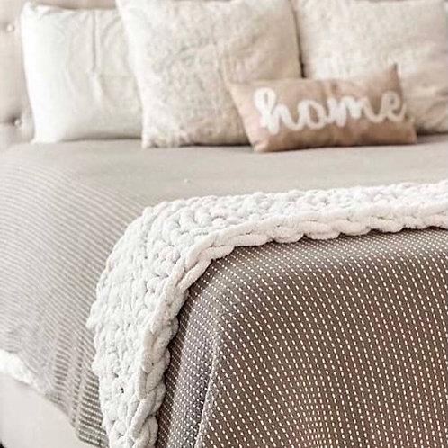 Hand knitted bed runner