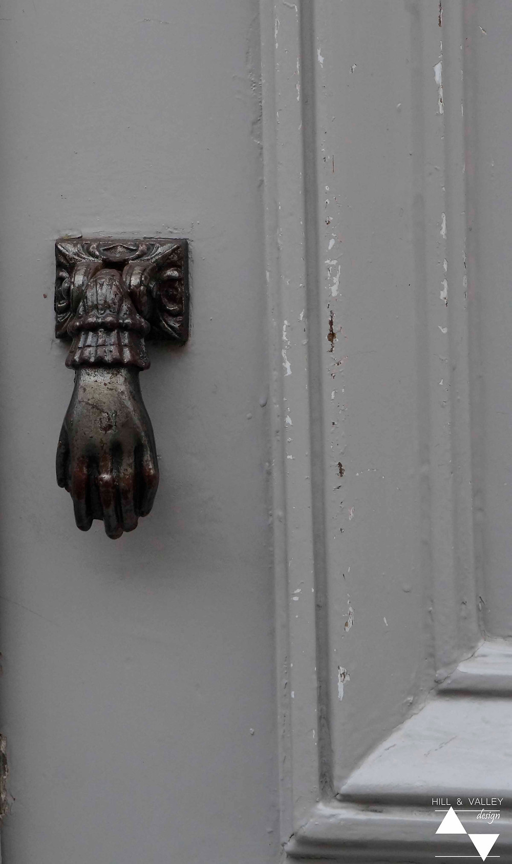 a curious door-knocker in Montmartre