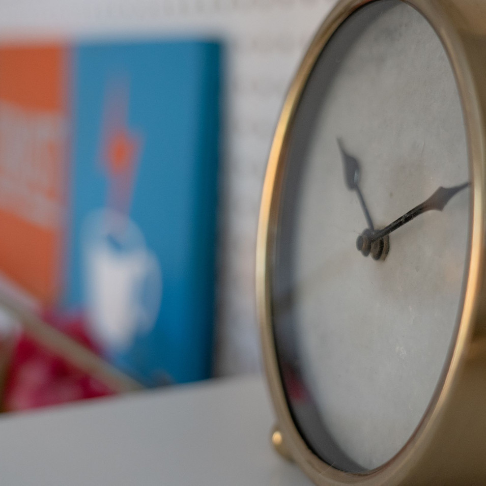 brass clock and sign art