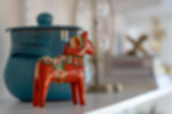 dala horse and blue lidded pot