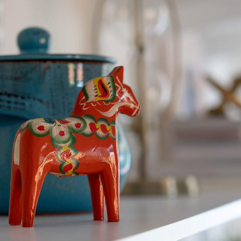 dala horse and blue lidded pot