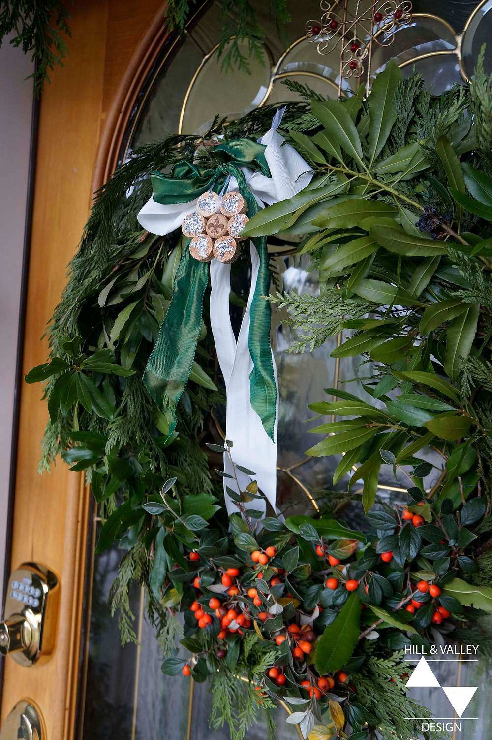 Holiday wreath using cedar, ribbon, wax myrtle,  hand-crafted ornaments