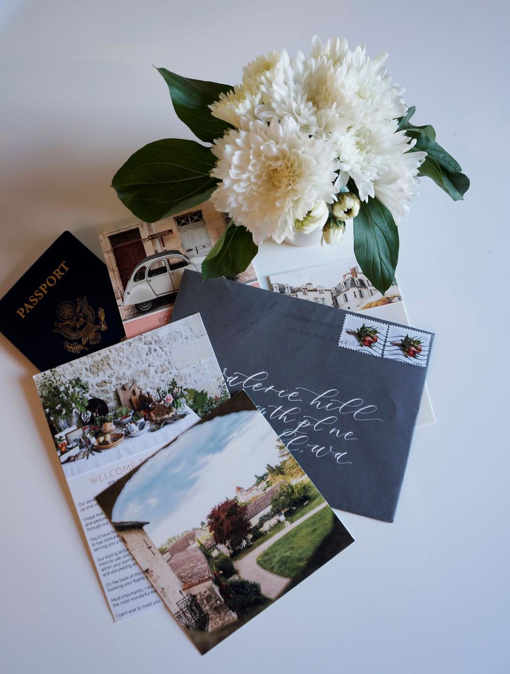 flat lay; flowers, passport; invitation