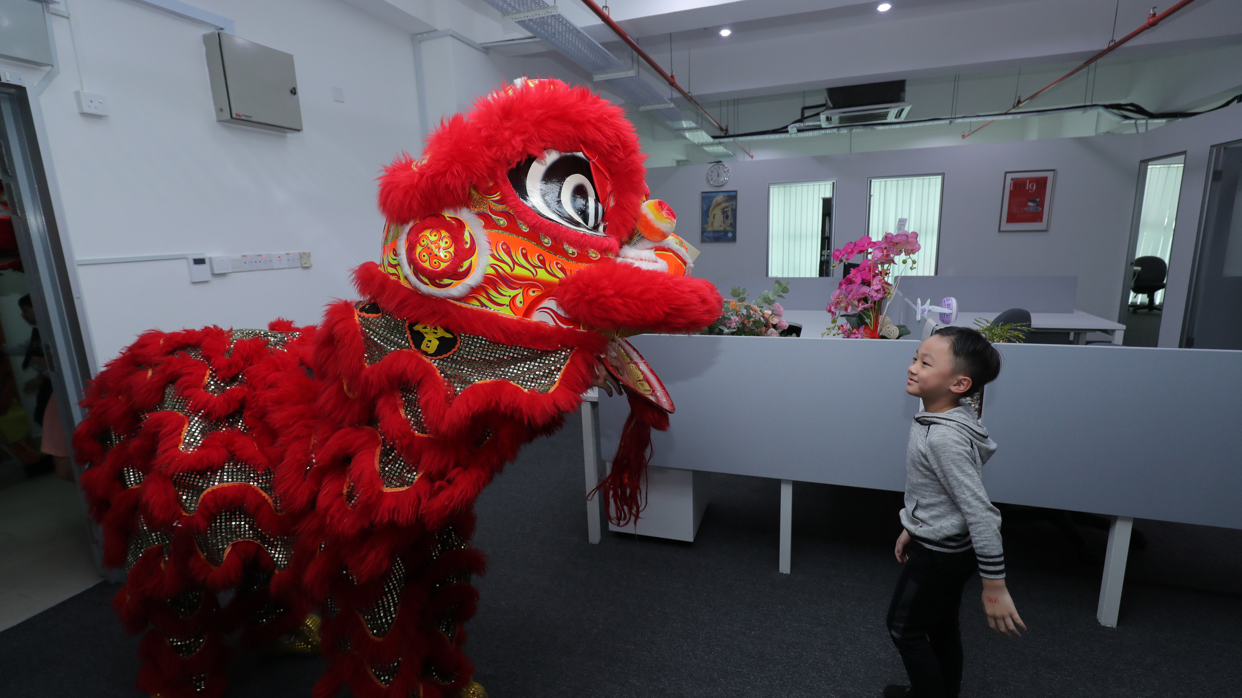 Lion dancing with a Kid
