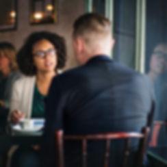 woman interviewing man.jpg