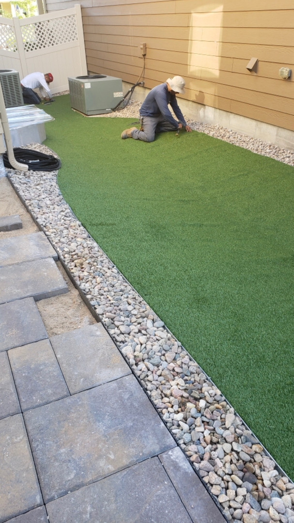 Turf with a rock border & pavers