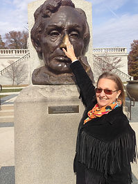 Laurie Fremgen, midwife, rubbing Lincoln's nose for good luck!