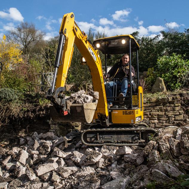 Sean on digger and bucket.jpg