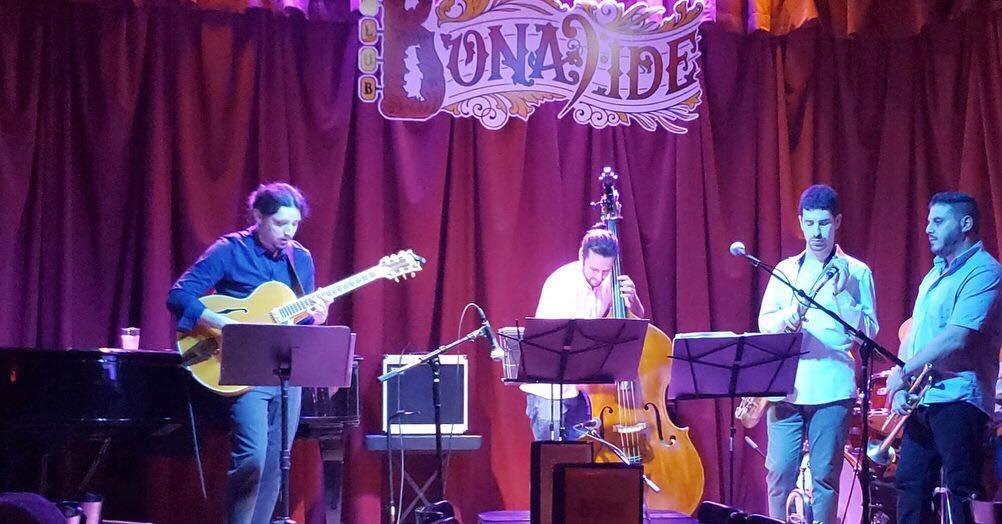 on stage at Club Bonafide