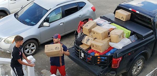 Typhoon Yutu Relief Receiving.jpg