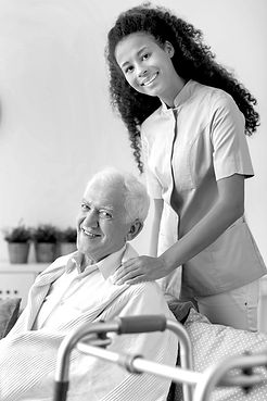 Photo of a nurse and elderly man smiling