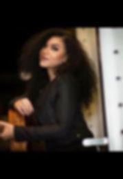 Desiree white with guitar.jpg