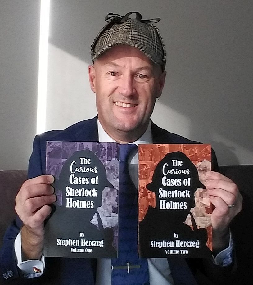 Steve Herczeg holding his two Sherlock Holmes collections