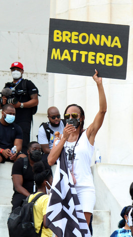 A protester shows support for Breonna Taylor during The March on Washington, Aug., 28, 2020, Washington, D.C.