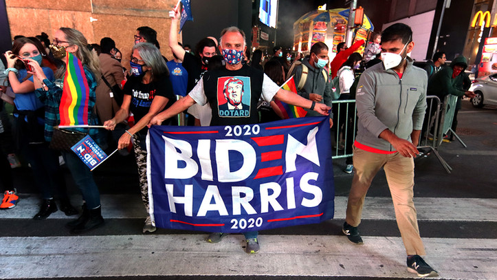 Joe Biden supporters celebrates after he was declared winner of the US presidential elections, Nov. 7, 2020, New York City.