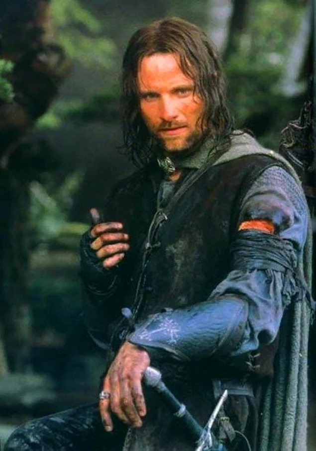 Aragorn wears Boromir's bracelets in the second and third movies to honor him