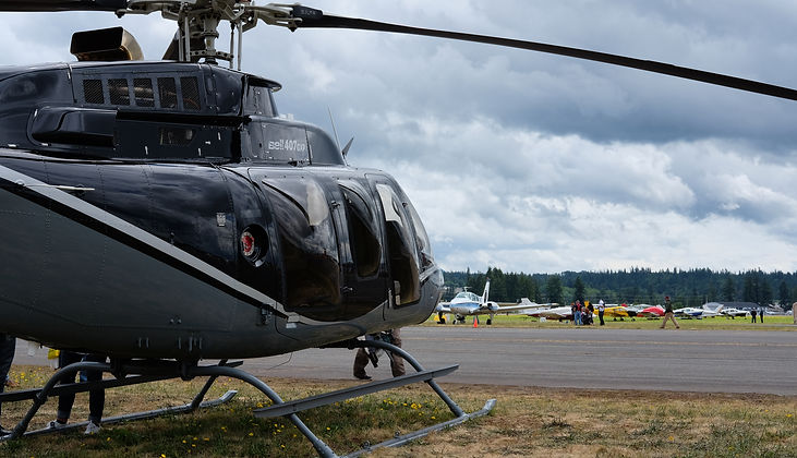 A Bell 407 helcopter awaiting takeoff