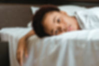 woman-in-white-shirt-lying-on-bed-sleepl