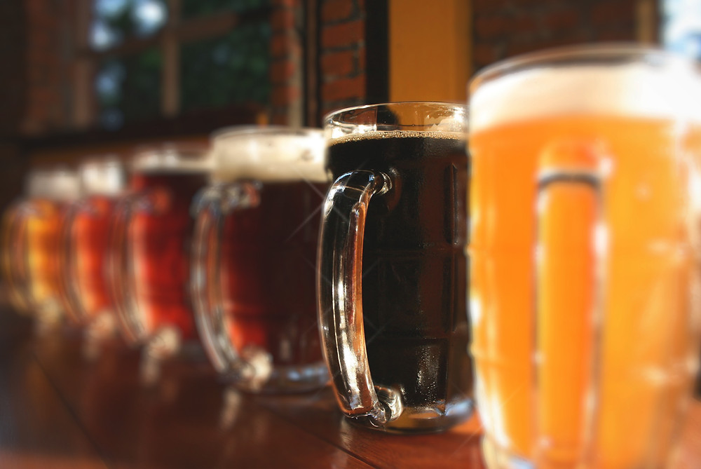 beer in glasses lined up