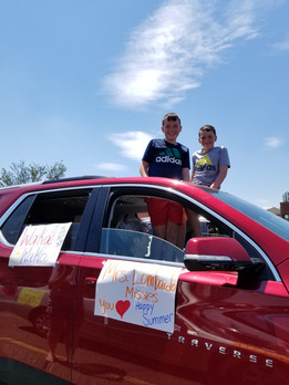 boys in red car