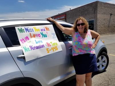 teacher with sign