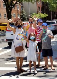 family waving
