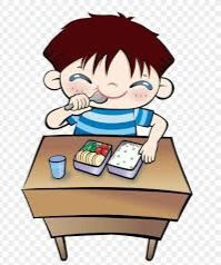 boy eating lunch at a desk