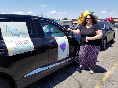 teacher next to car