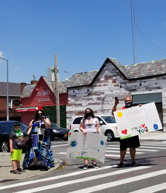 family holding signs