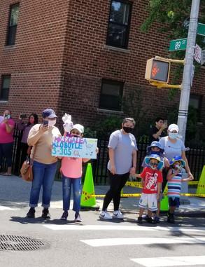family standing on street