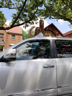 white car with teacher