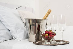 44252421-champagne-in-bed-in-a-hotel-roo