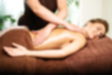 Beautiful young woman having massage in
