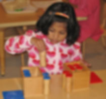 Montessori Primary Full Day & Kindergarten - Girl with sound cylinders