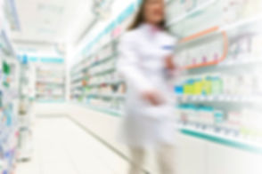 Pharmacist%20%20in%20aisle%20of%20Pharmacy_edited.jpg