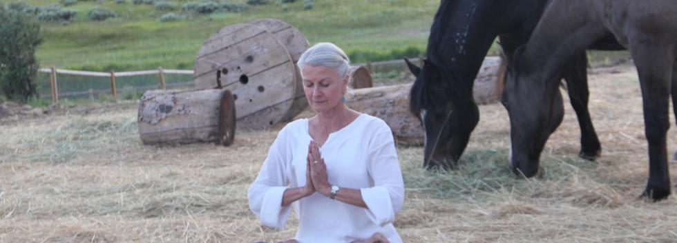 Maggie meditates before leading yoga